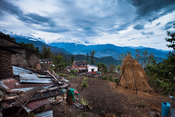 The Annapurna operation of of a Himalayas frames a encampment of Kaskikot in Nepal, and a residence Bethesda local Laura  Spero lives in, center. The vast smoke-stack of straw is used to feed animals and also to make mats and other domicile items.