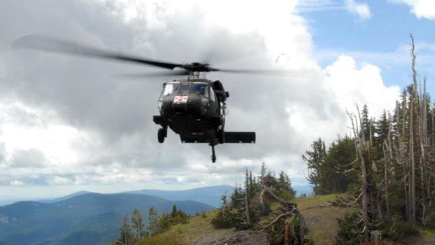 In this print granted by a Clackamas County Sheriff's office, an Oregon National Guard Blackhawk helicopter lands during Timberline Lodge nearby Government Camp, Ore., as a hunt for a mislaid traveller continues on Mount Hood Thursday, Jun 27, 2013.